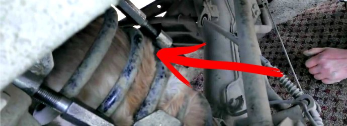 Russians Rescue Cat Stuck In Their Car Suspension Spring After Riding 40 Miles. Wow!
