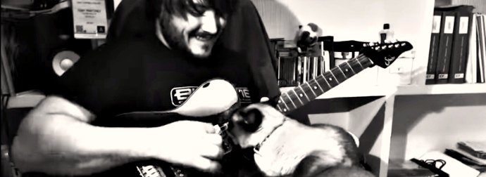 She Wanted To Be A Guitar-Hero Cat, So She Made Her Rockstar Cat-Dad Show Her The Strings